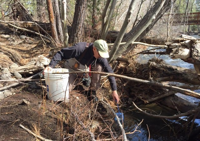 John Planting Spring Chinook Fry in Whychus Creek | www.johnkreft.com